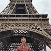 Tom Baker in front of Eiffel Tower.