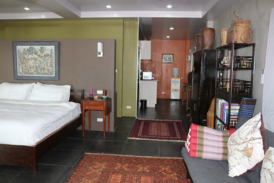 Colugo One Bedroom Seafront Villa bedroom and lounge area, East Coast, Ko Lanta