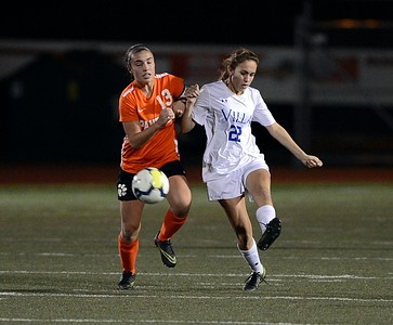 Sydney Riley (22) clears ball by Madison Ernst (13).
