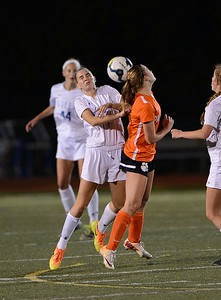 Tara Schmidt (11) battles Pennsboro defender for header.