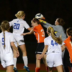 Casey Kilchrist's (20) header is blocked by Ashley Wertz (32) and goalie Michelle Hocker (1).
