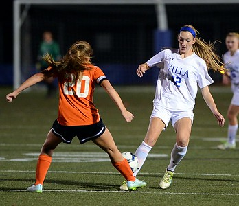 Miranda Behr (42) tries to get by Allison Langland (20).