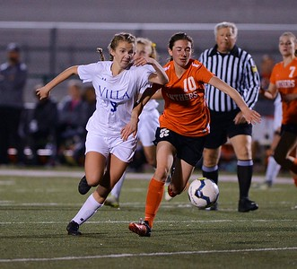 Megan O'Neil (9) beats Hannah Young (10) to the ball.