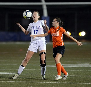 Shannon Coleman (17) controls ball in front of Madison Walker (6).