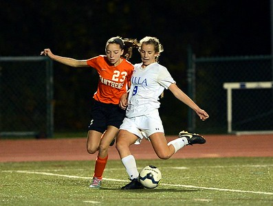 Megan O'Neil (9) beats Kylie Wertz (23) to the ball.