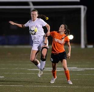 Shannon Coleman (17) and Madison Wertz (6) battle for possession.
