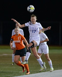 Shannon Coleman (17) goes up for header.