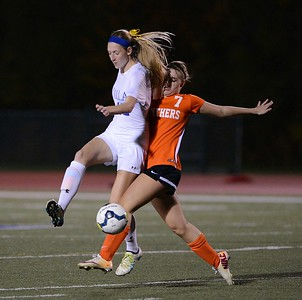 Miranda Behr (42) gets ball around Alex Houdeshell (7).