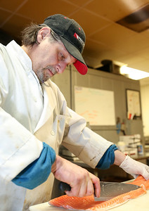 Joe Petrunti prepares Atlantic Salmon at The Village Cafe and Bistro.  Photo by John Fitts