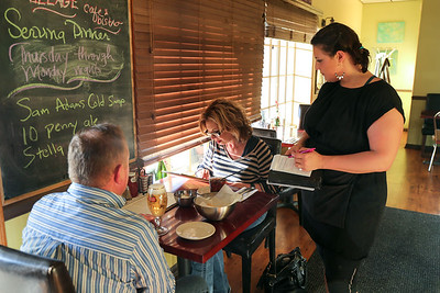 Village Cafe manager Jane Day waits on Bernie and Lisa Mullins of Southington.  Photo by John Fitts.