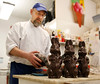 HOLLY PELCZYNSKI - BENNINGTON BANNER Ken Monte, chocolatier at the Village Chocolate Shoppe in Bennington takes chocolate bunnies out of their molds as the shoppe prepares for the Easter rush.