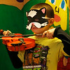 HOLLY PELCZYNSKI - BENNINGTON BANNER Damion Gibbs, a kindergartner at The Village School of North Bennington plucks a few strings while playing the part of the cat and the fiddle during a Mother Goose nursery rhyme play held on Friday morning.