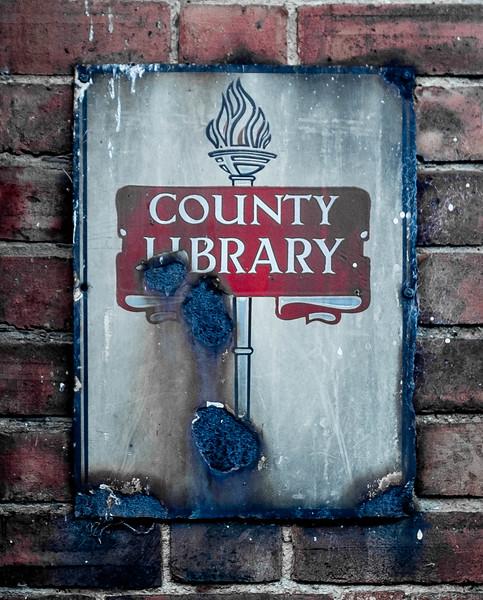 enamel Northamptonshire County Library sign, Church Street, Brixworth, Northamptonshire