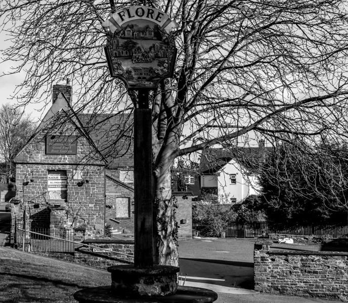 Village sign, High Street, Flore, Northamptonshire