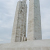 Upper left (south) pylon: Hope (l), Faith (c), Justice (r)<br>Centre, bottom of pylons: Torch bearer (upper), Sacrifice (lower)<br>Bottom: Names of Canadian soldiers.