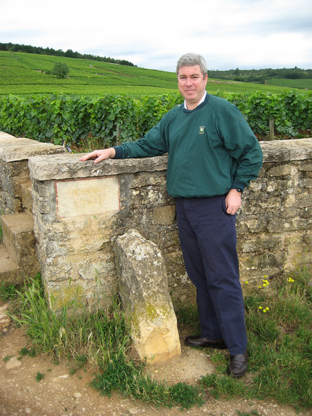 Bob is not going to be happy that the sign cannot be read.  Hear yee, hear yee, this is Bob Heine at the wall of Romanee Conti!