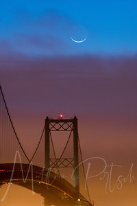 Crescent moon above the bridge