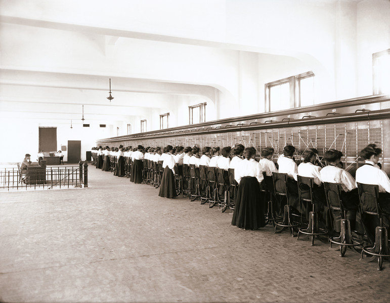 """Over 50 women telephone switchboard operators and their supervisors. During this period (circa 1914), only young women (not men) were hired for this type of work at a Salt Lake City, Utah company. This photo was scanned from an 8x10 glass negative contact print.  The """"XLarge"""" and smaller photo sizes are FREE for any personal use (under a <a href=""""http://creativecommons.org/licenses/by-nc-nd/2.0/"""">Creative Commons</a> license). Click the """"Buy"""" or shopping cart button (above the image) to purchase prints or downloads. PRICING: 1-megapixel Personal downloads are $1.89;  4-megapixel and """"Original"""" (15-megapixel) Personal downloads are $4.95, 1-megapixel Commercial downloads are $9.95, 4-megapixel and """"Original"""" (13-megapixel) Commercial downloads are $49.95. NOTE: Free personal use requires a photo credit to my company, ''<a href=""""http://www.tssphoto.com/"""">The Stock Solution</a>'', and link to that Web site if you use the image on a personal Web site."""