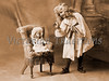 """Young girl lecturing her doll - a vintage photograph. NOTE: This image is only available in the 1-megapixel size (do not waste your money on the 4-megapixel or """"Original"""" size, as they are still only 1-megapixel when opened :)"""