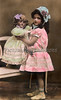 "Young girl playing with her doll - a vintage, hand-tinted photograph. NOTE: This image is only available in the 1-megapixel size (do not waste your money on the 4-megapixel or ""Original"" size, as they are still only 1-megapixel when opened :)"