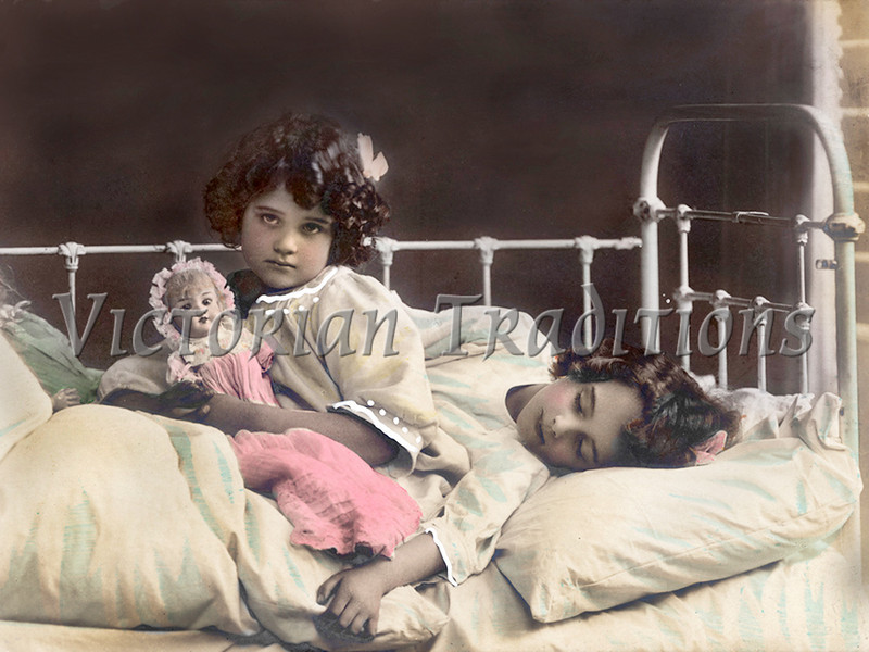 """Little girl playing with her doll while her sisters sleeps in bed - a vintage, hand-tinted photograph. NOTE: This image is only available in the 1-megapixel size (do not waste your money on the 4-megapixel or """"Original"""" size, as they are still only 1-megapixel when opened :)"""
