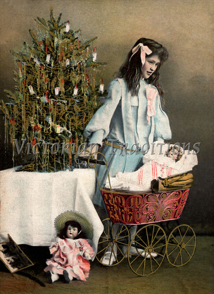"""Little girl playing with her Christmas dolls and carriage - a 1907 vintage, hand-tinted photo. Your purchased prints & downloads will NOT have """"Victorian Traditions"""" watermark."""