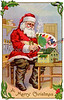 'A Merry Christmas' - Santa Claus in his workshop, painting a doll house - a circa 1915 vintage greeting card illustration