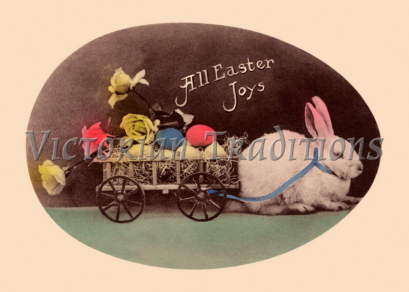 An Easter bunny pulling a cart of eggs - A vintage, hand-tinted photographic greeting card, circa 1910