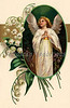 """Easter angel surrounded by Lily of the Valley flowers - a Victorian greeting card illustration, circa 1909. (To purchase prints or downloads, click on the """"Buy"""" or shopping cart button above the image; then choose """"This Photo"""", followed by clicking on the 'Prints', 'Merchandise', or 'Downloads' tab.)"""