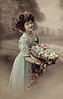 Woman with a basket of colored Easter eggs - A Victorian Era hand-tinted photograph, circa 1915
