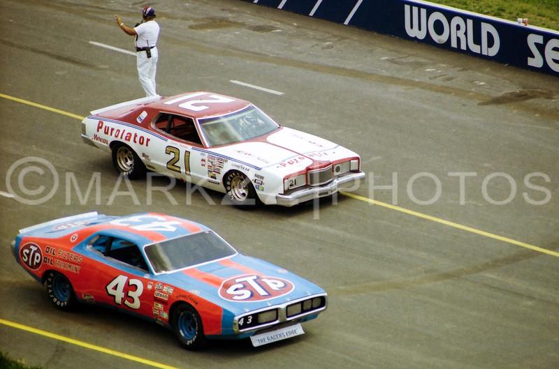 David Pearson (21) and Richard Petty 43) 1977 World 600 CMS