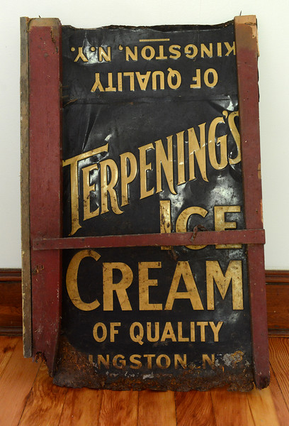 Tania Barricklo-Daily Freeman This Terpening's Ice Cream sign was one of the signs being used for insulation in the basement which Basile uncoverd while restoring the cottage.