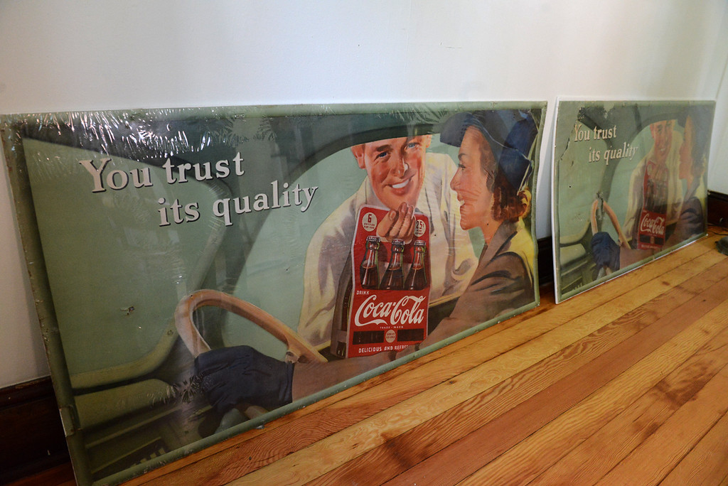 . Tania Barricklo-Daily Freeman  Two Coca Cola signs in mint condition were used as insulation in the basement and uncovered by Basile when restoring the 1935 cottage kit.