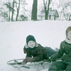 Garry, Bonnie, snow sledding