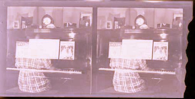 Double exposure of someone at the player piano. Steve scanned these.