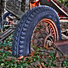 A wheel from a horse drawn wagon of the past