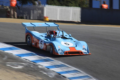 Chris MacAllister drives a 1973 Gulf Mirage through the Corkscrew.