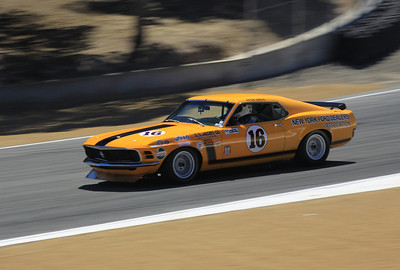 The 1970 Boss 302 Mustang driven by Ken Epsman heads toward turn 9.