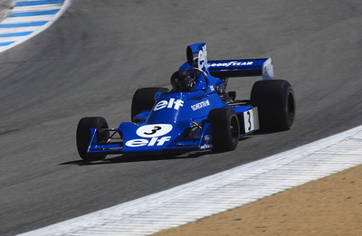 A 1974 Tyrell 7 Formula 1 car once driven by Jody Scheckter exits the Corkscrew.