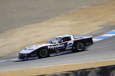 John Goodman drives a 1988 Chevrolet/Protofab Corvette through the Corkscrew.