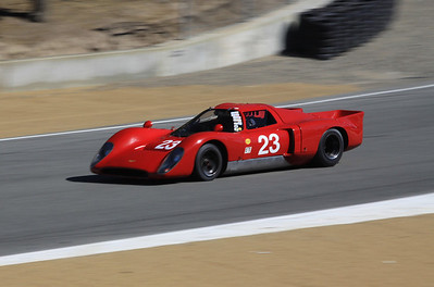 A 1969 Chevron B16 droven by Bob Kullas heads down the hill toward turn 9.