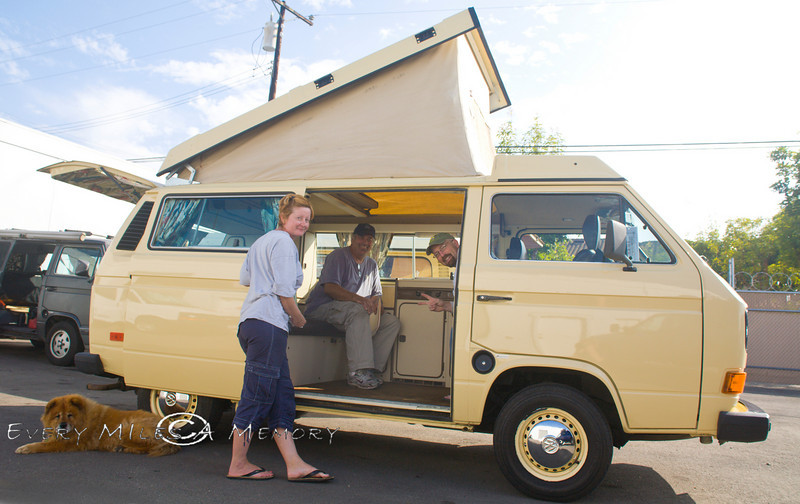 Pat getting the Lowdown from Bil & Diane in the VW Surfari lot - Photo by Cindy Bonish