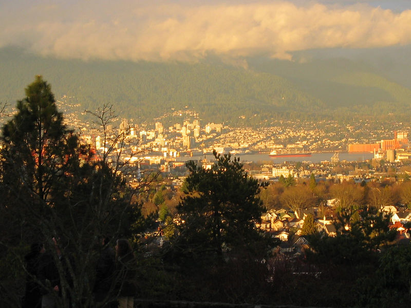 The sun beaks through, giving us a view of North Vancouver from Little Mountain.