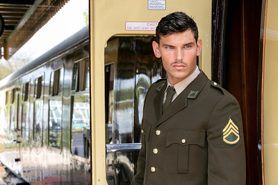 Handsome male American officer in vintage uniform leaving train at train station