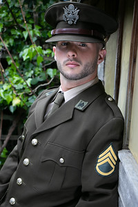 Handsome male american officer in vintage uniform looking at camera