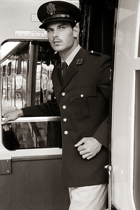 Handsome male American officer in vintage uniform leaving train carriage at railway station