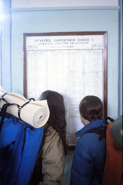Margie and Annie check the train schedule, December 15, 1979.