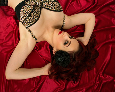 Moxie Valentine on red satin