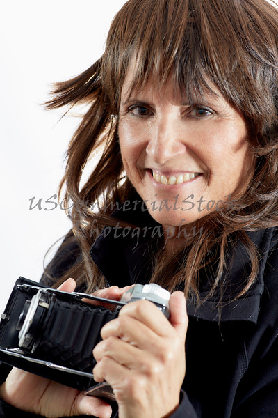 Attractive Woman holding an Antique Camera