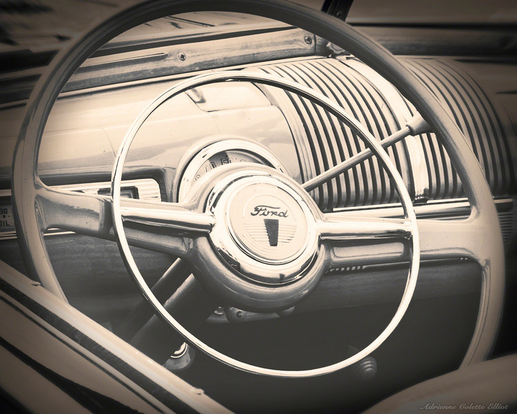This image features the steering wheel of a historic 1948 Ford Dunesmobile car. A fleet of these cars was once used to transport visitors on a 12 mile tour around the scenic Sleeping Bear Dunes National Lakeshore in and around Glen Haven, Michigan.